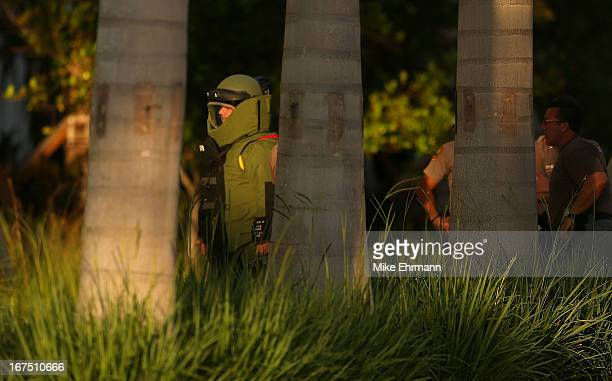 Members of the Miami Police Department's Bomb Squad investigate a package during a game between the Miami Marlins and the Chicago Cubs at Marlins...