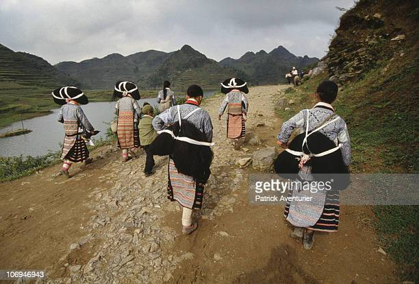 Members of the Miao ethnic minority group walk near their village September 1993 in Guizhou Province China The Miao are a linguistically linked group...