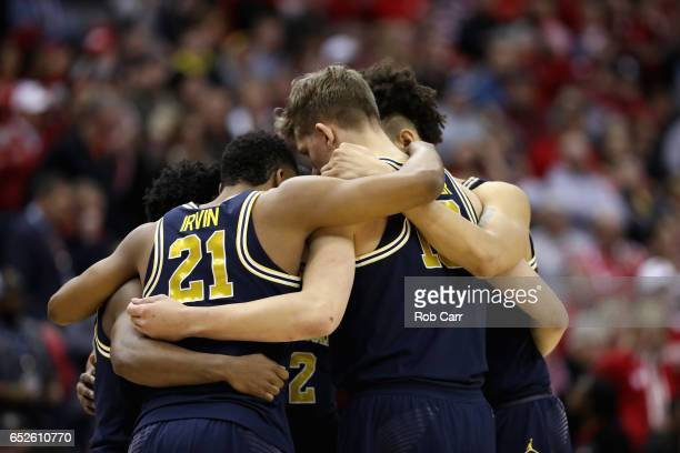 Members of the Michigan Wolverines huddle before the start of their game against the Wisconsin Badgers during the Big Ten Basketball Tournament...