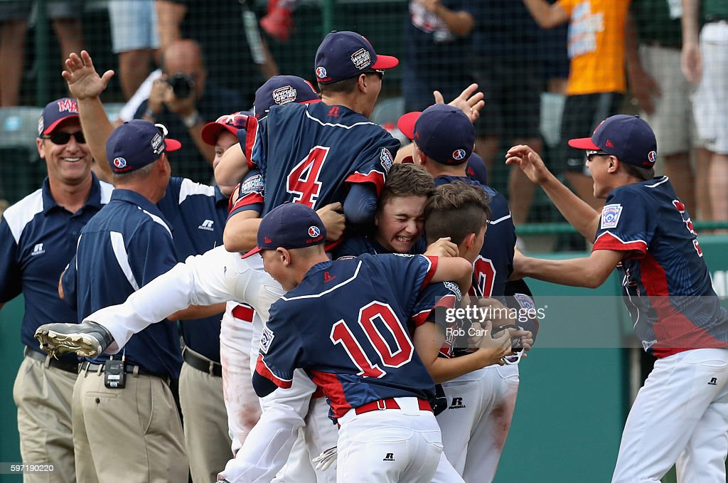 Members of the Mid-Atlantic Team from New York celebrate after defeating the Asia-Pacific team from South Korea 2-1 to win the Little League World Series Championship Game at Lamade Stadium on August 28, 2016 in South Williamsport, Pennsylvania.
