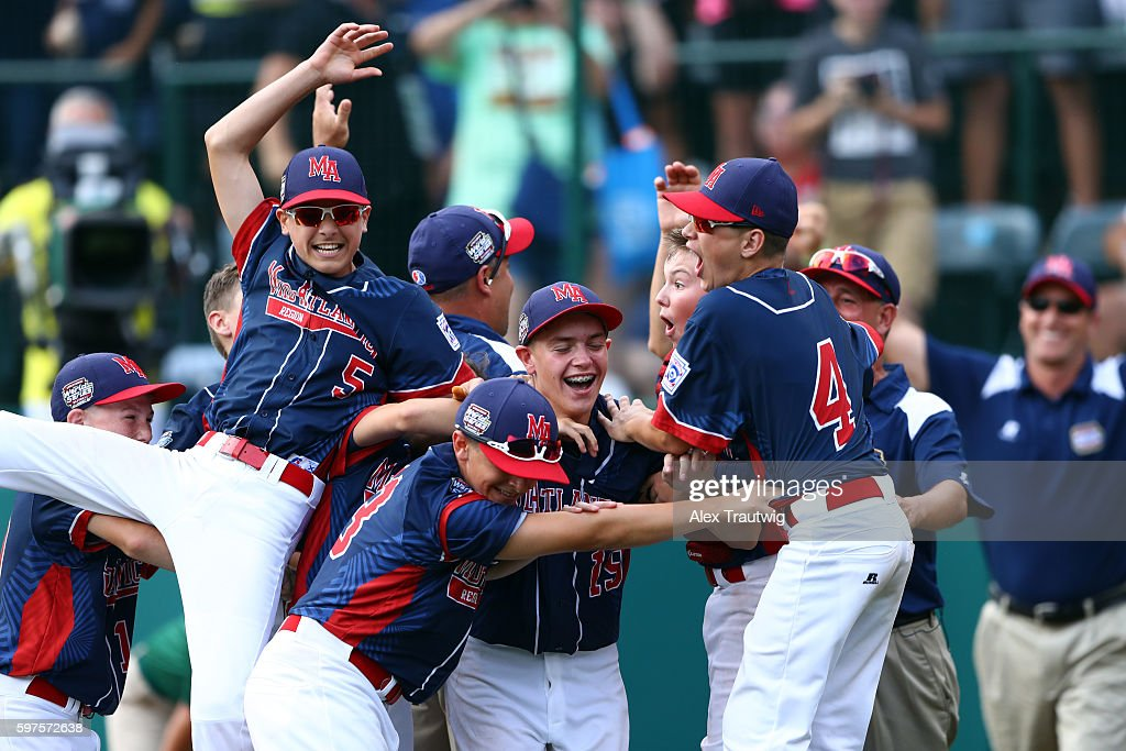 Members of the Mid-Atlantic Team from New York celebrate after defeating the Asia-Pacific Team from South Korea in the World Series Championship Game at Lamade Stadium during the Little League World Series on Sunday, August 28, 2016 in Williamsport, Pennsylvania.