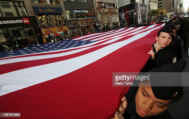 Members of the Middletown High Schoool JROTC carry the American flag during the annual Veterans Day parade November 11 2010 in New York City The...
