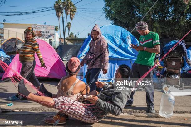Members of the migrant caravan are seen resting in a makeshift camp as they wait to apply for asylum in the United States Around 6000 migrants are...