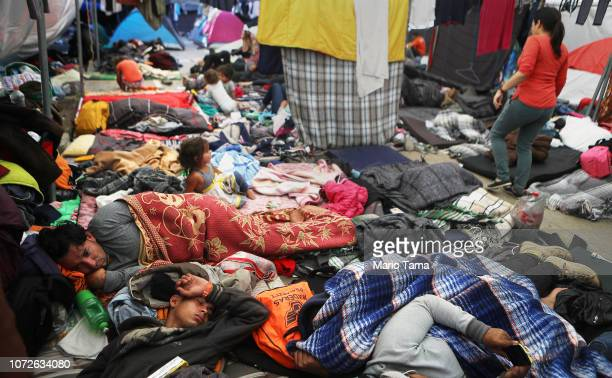 Members of the 'migrant caravan' rest in a temporary shelter set up for members of the caravan on November 26 2018 in Tijuana Mexico Around 6000...