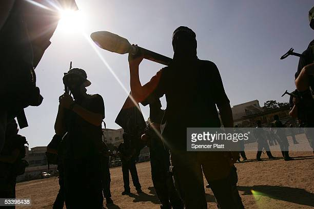 Members of the militant wing of Fatah participate in a rally August 16, 2005 in Gaza City, Gaza Strip. Israel closed off all entry into the...