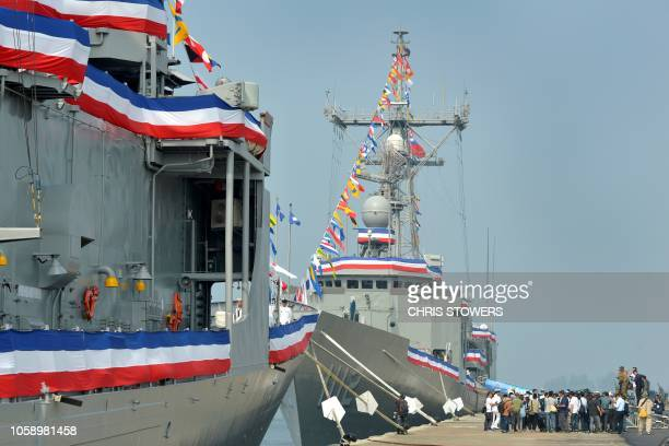 Members of the military and journalists gather on the dock as the 'Feng Chia' and 'Ming Chuan' navy frigates are pictured during a ceremony to...