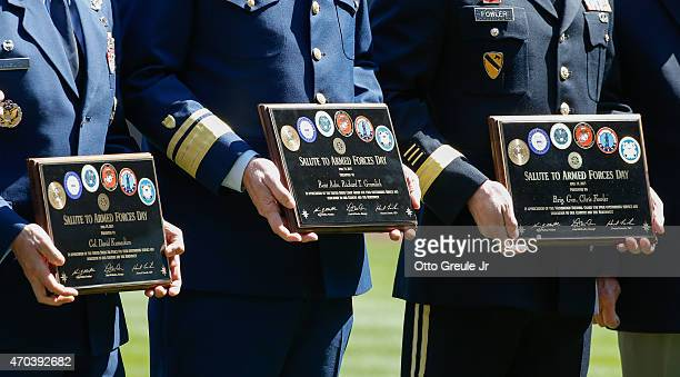 Members of the military are honored prior to the game between the Seattle Mariners against the Texas Rangers as part of Salute to Armed Forces Day at...