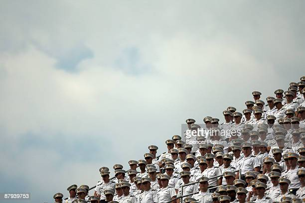 Members of the military attend graduation ceremonies at the United States Military Academy at West Point May 23 2009 in West Point New York Secretary...