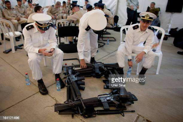 Members of the military await an official welcoming ceremony for US President Barack Obama on his arrival at Ben Gurion Airport on March 2013 near...
