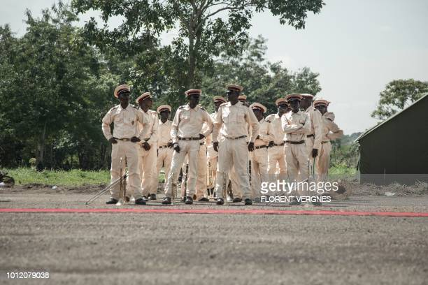 Members of the military band of the Central African Armed Forces stand ahead of an award presentation in Berengo on August 4, 2018. - Russian...