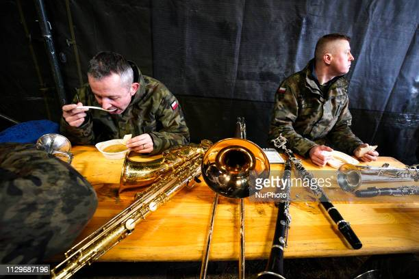 Members of the military big band are seen having lunch in Bydgoszcz Poland on March 9 2019 The local military base organized a public picnic on the...