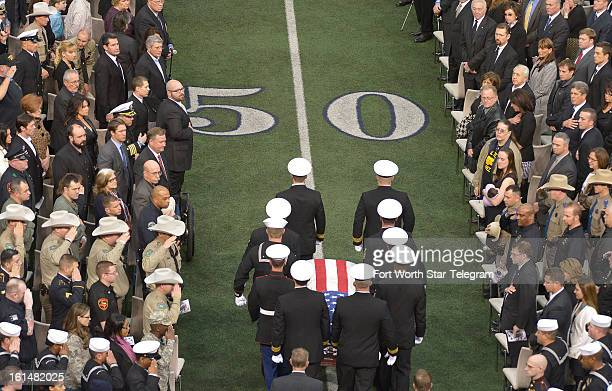 Members of the military carry the casket of Chris Kyle at Cowboys Stadium in Arlington Texas Monday February 11 2013 Kyle was a highly decorated...