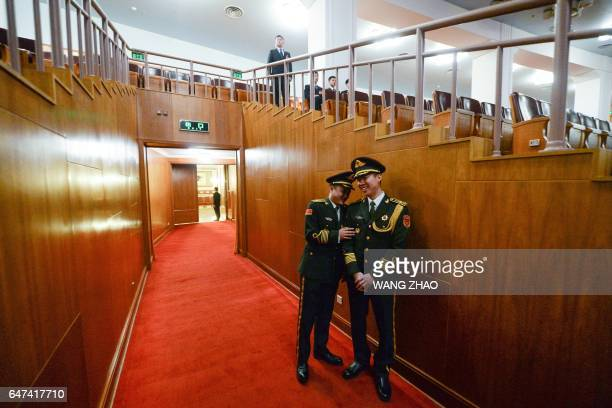 TOPSHOT Members of the military chat before the opening session of the Chinese People's Political Consultative Conference at the Great Hall of the...