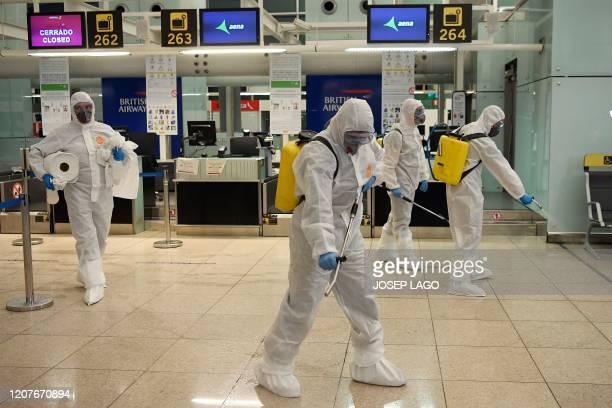 Members of the Military Emergencies Unit carry out a general disinfection at Josep Tarradellas BarcelonaEl Prat airport in El Prat de Llobregat on...