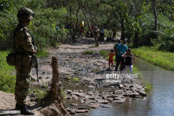 Members of the military guard a crossing point near the Venezuelan border in Cucuta, Colombia, Thursday, Oct. 7, 2021. Venezuela reopened the borders...