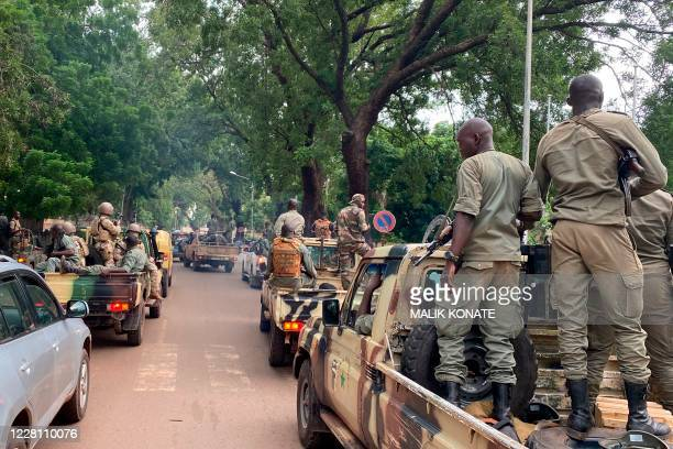 Members of the military junta arrive with their escorts at the Malian Ministry of Defence in Bamako on August 19 2020 The military junta that took...