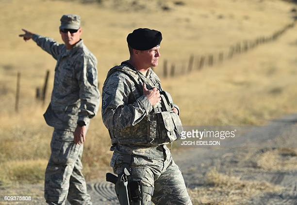 Members of the military look on near site where an Air Force U2 crashed in Sutter California on September 20 2016 A US pilot was killed and another...