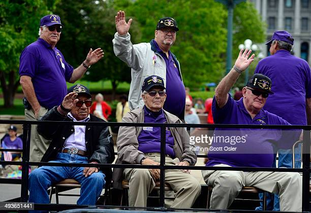 Members of the Military Order of the Purple Heart make their way down Broadway as the Memorial Day Parade and the 15th Annual Memorial Day Tribute...