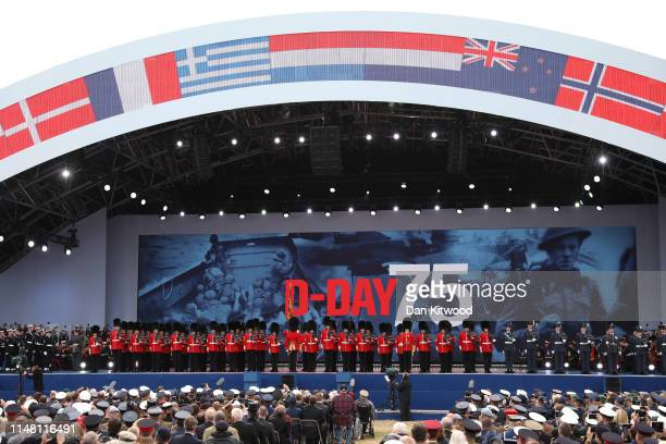 Members of the military parade on stage during the DDay Commemorations on June 5 2019 in Portsmouth England The political heads of 16 countries...