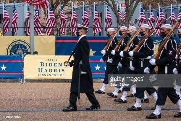 Members of the military participate in a dress rehearsal of the inauguration parade on Pennsylvania Avenue in front of the White House on January 18,...