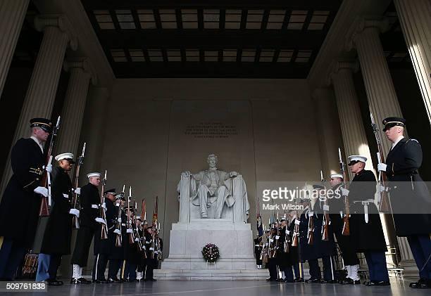 Members of the military participate in a wreath laying ceremony at the Lincoln Memorial February 12 2016 in Washington DC The Military District of...