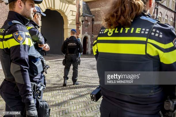 Members of the military police arrive to heighten security around the Binnenhof The Hague on March 18 2019 A gunman opened fire on a tram in the...