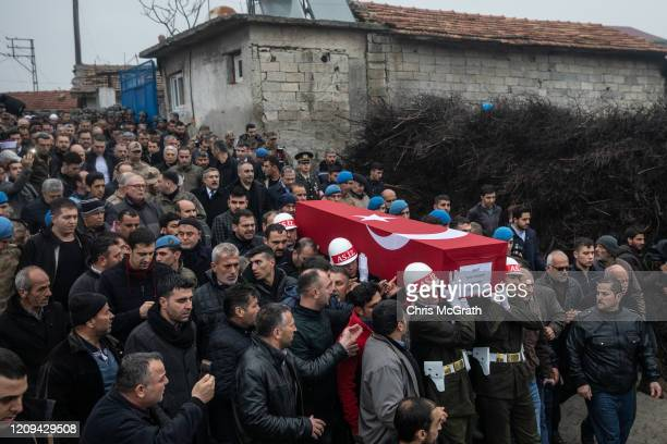 Members of the Military Police of the Turkish Armed Forces carry the coffin of Turkish soldier Emin Yildirim who was killed in an airstrike in Idlib...