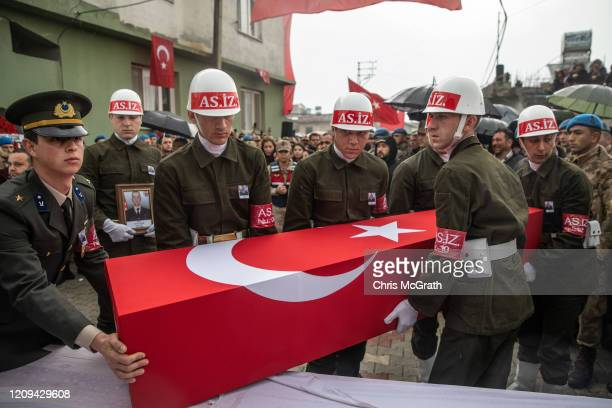 Members of the Military Police of the Turkish Armed Forces carry the coffin of Turkish soldier Emin Yildiri who was killed in an airstrike in Idlib...