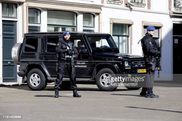 Members of the military police stand guard around the Binnenhof The Hague on March 18 2019 A gunman opened fire on a tram in the Dutch city of...