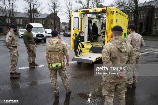 Members of the military practice loading and unloading a stretcher into an ambulance at Maindy Barracks on December 23, 2020 in Cardiff, Wales. The...