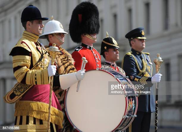 Members of the military Senior Drum Major Betts of the Scots Guards Bugler Lee Kidd of the Royal Marines Guardsman Andy Dear of the Coldstream Guards...