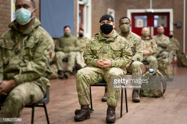 Members of the military sit through an induction process at Maindy Barracks on December 23, 2020 in Cardiff, Wales. The Welsh Ambulance Service has...