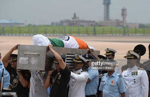 Members of the military staff carry the coffin of former Indian President APJ Abdul Kalam at Palam Airforce Station in New Delhi on July 28 after its...