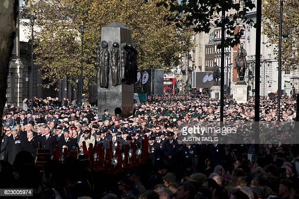 Members of the military stand during the Remembrance Sunday ceremony at the Cenotaph in Whitehall London on November 13 2016 Services are held...