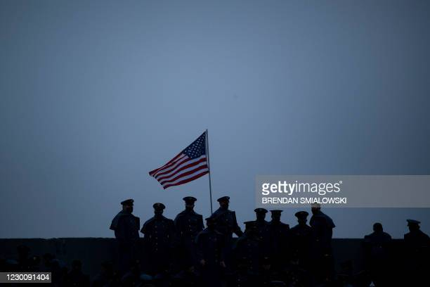 Members of the military stand near the US National flag during the Army-Navy football game at Michie Stadium on December 12, 2020 in West Point, New...