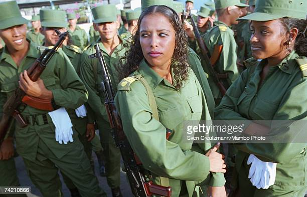 Members of the military wait to march in a parade as part of celebrations on Revolutionary Armed Forces Day on December 2 2001 in Santiago Cuba This...