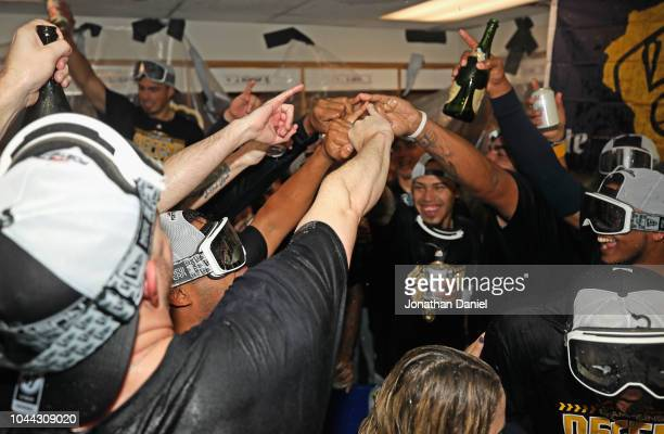 Members of the Milwaukee Brewers celebrate in the locker room after beating the Chicago Cubs in the National League Tiebreaker Game at Wrigley Field...