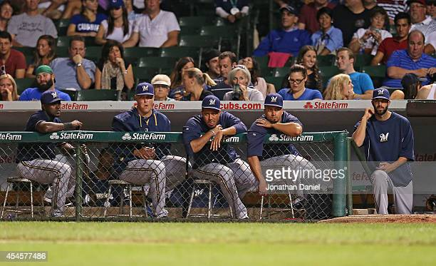 Members of the Milwaukee Brewers watch as the Chicago Cubs sweep the series at Wrigley Field on September 3 2014 in Chicago Illinois The Cubs...