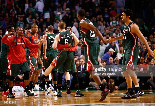 Members of the Milwaukee Bucks including OJ Mayo and Nate Wolters celebrate in the fourth quarter after taking the lead against the Boston Celtics...
