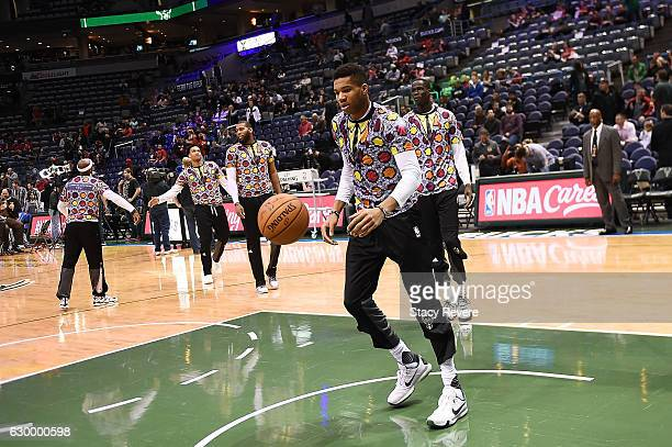Members of the Milwaukee Bucks wear shirts honoring the late Craig Sager during warmups prior to a game against the Chicago Bulls at the BMO Harris...