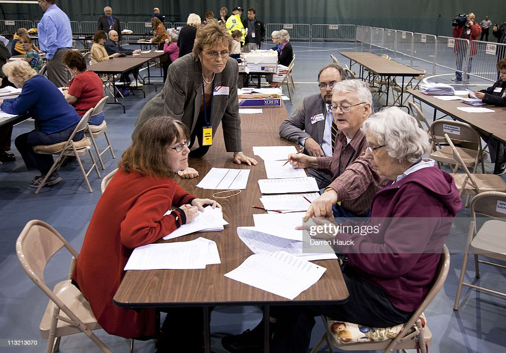 Members of the Milwaukee County Election Commission recount the ballots for the Wisconsin Supreme Court race between incumbent Justice David Prosser and Assistant Attorney General JoAnne Kloppenburg at the Milwaukee County Sports Complex on April 27, 2011 in Milwaukee, Wisconsin. Observers from the Prosser and Kloppenburg campaign were overseeing the process to validate the recount.