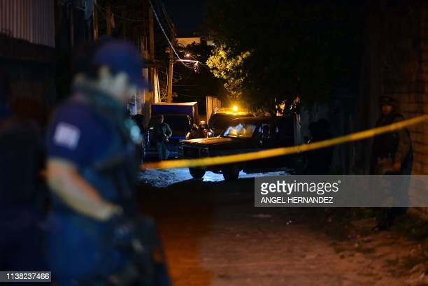 Members of the Minatitlan municipal police stand guard outside the place where 13 people were killed in a shooting, in Minatitlan, Veracruz State,...