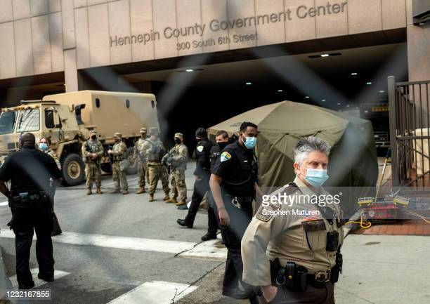 Members of the Minnesota National Guard, Hennepin County Security Department, and Hennepin County Sheriff's stand watch outside the Hennepin County...