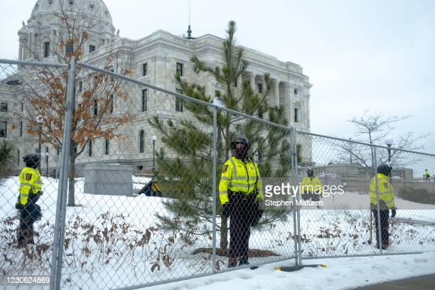 Members of the Minnesota State Patrol stand guard outside the Capitol building on January 16, 2021 in St Paul, Minnesota. Supporters of President...
