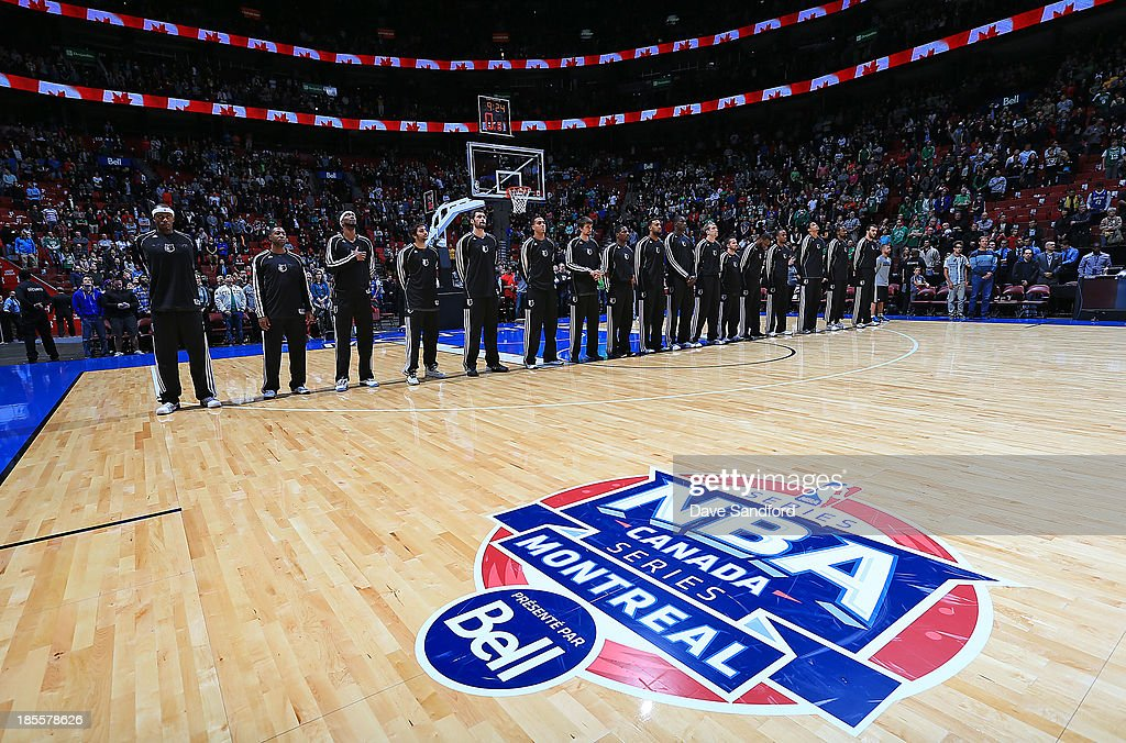 Members of the Minnesota Timberwolves stand for the national anthems prior to facing the Boston Celtics during their NBA pre-season game at the Bell Centre on October 20, 2013 in Montreal, Quebec, Canada.