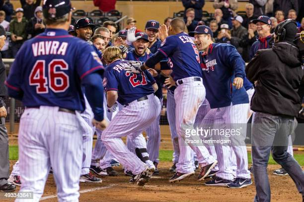 Members of the Minnesota Twins celebrate a walk-off home run hit by Chris Parmelee against the Boston Red Sox on May 13, 2014 at Target Field in...