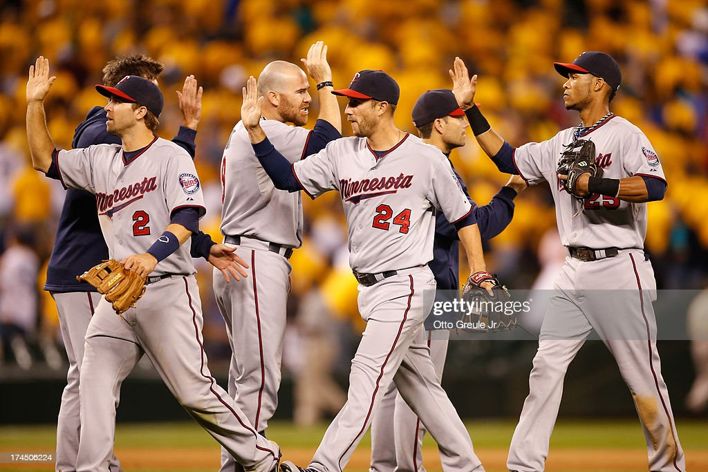 Members of the Minnesota Twins celebrate after defeating the Seattle Mariners 3-2 in thirteen innings at Safeco Field on July 26, 2013 in Seattle, Washington.