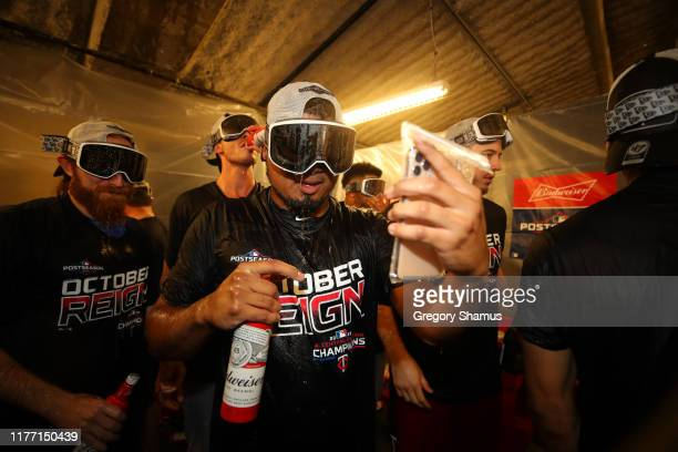 Members of the Minnesota Twins celebrate winning the American League Central Division title after a 51 win against the Detroit Tigers and a Cleveland...