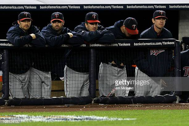 Members of the Minnesota Twins look on dejected from the dugout late in the game against the New York Yankees during Game Three of the ALDS part of...