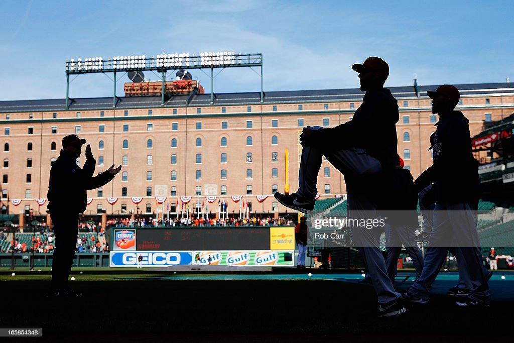 Members of the Minnesota Twins stretch prior to the start of their game against the Baltimore Orioles at Oriole Park at Camden Yards on April 6, 2013 in Baltimore, Maryland.